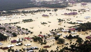 An aerial view shows houses submerged in floodwater in the district of Aceh Tamiang